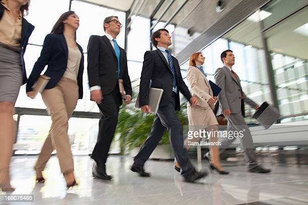 Business people walking together in lobby