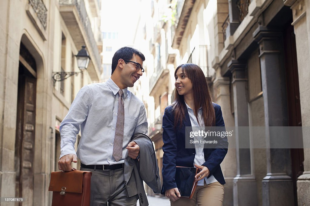 Business people walking together on city street : Stock Photo