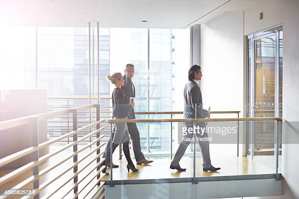 Business people walking together towards meeting