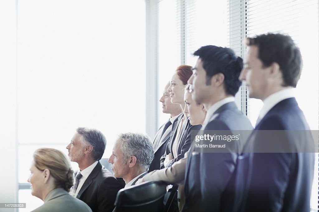 Business people watching presentation in conference room : Stock Photo