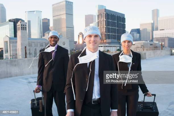 Business people wearing medical masks on urban rooftop