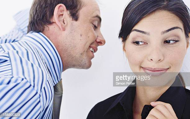 Business people whispering in office