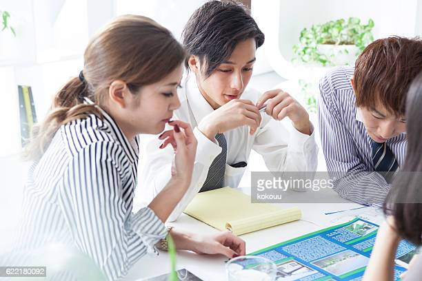 Business People who are meeting while watching documents
