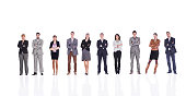 Business people with crossed arms isolated on white.