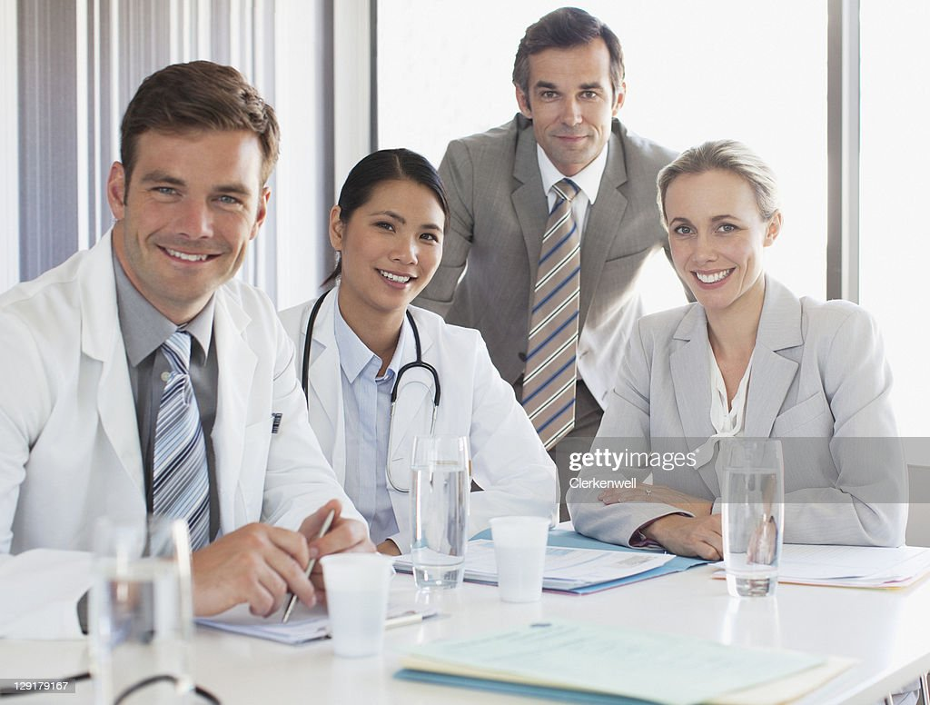 Business people with doctors : Stock Photo