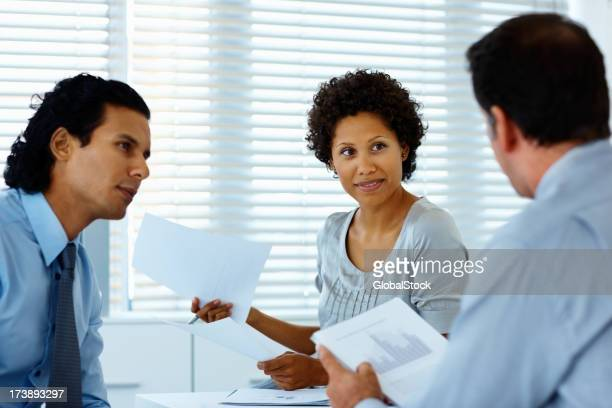 Business people with documents in a meeting
