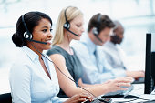 Business people with headset on working in a call center