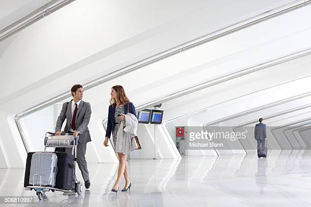 business people with luggage trolley in airport