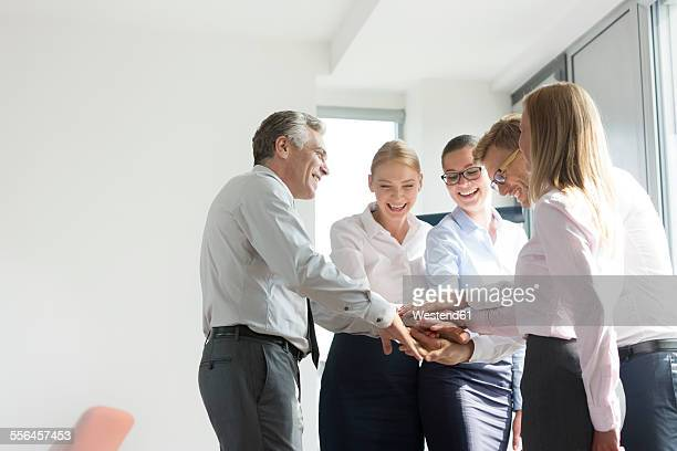 Business people with piled hands, bonding for success
