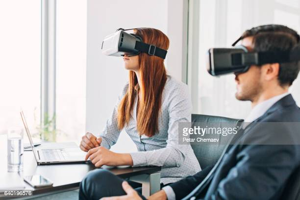 Business people with VR headsets