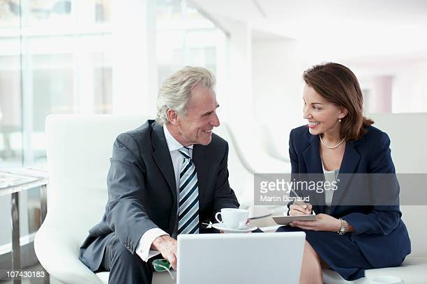 Business people working and drinking coffee