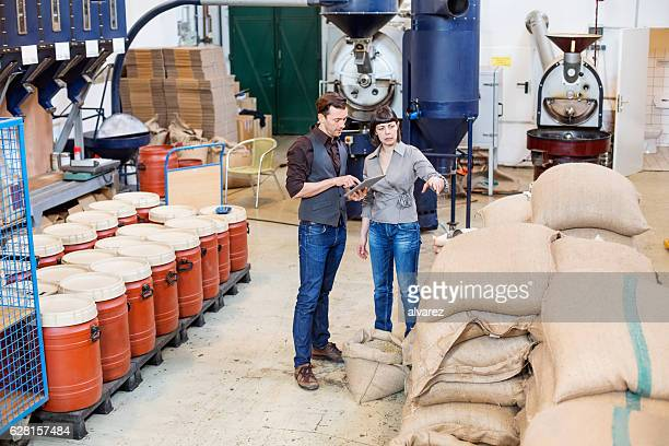 Business people working at coffee roasting factory