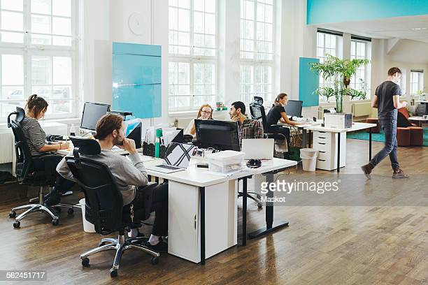 Business people working at desks in creative office