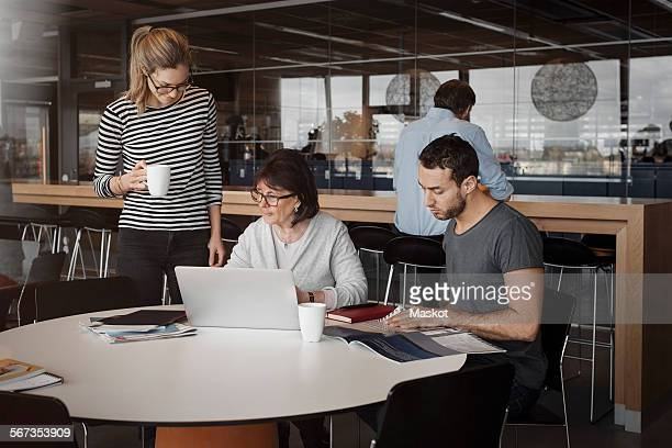 Business people working at office cafe