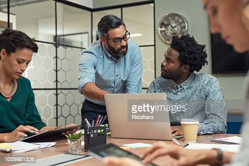 Business people working in a meeting room : Stock Photo