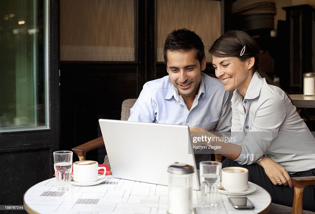 business people working in café using laptop : Stock Photo