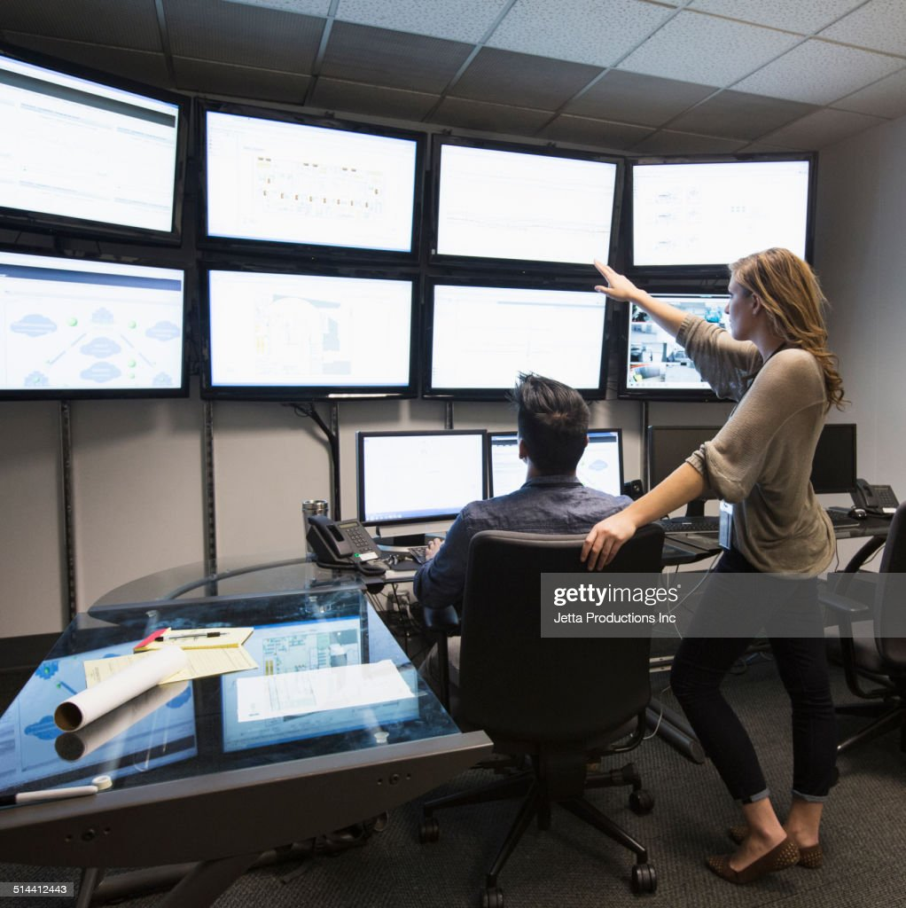 Business people working in control room