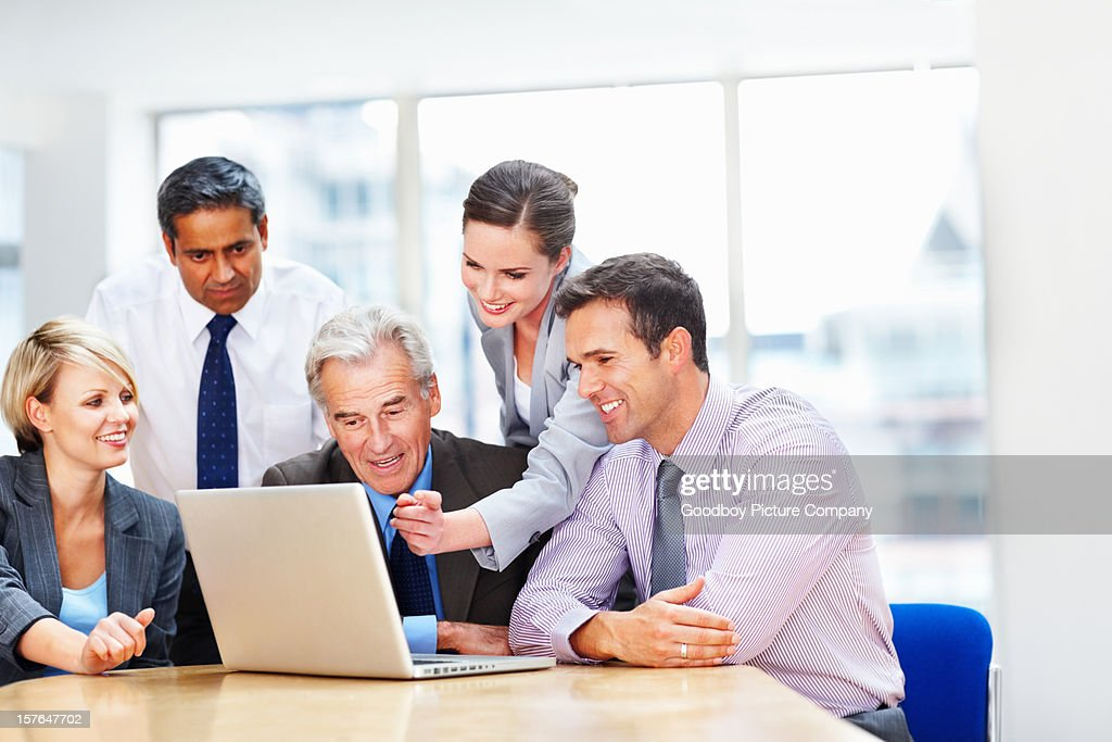 Business people working on a laptop at office : Stock Photo
