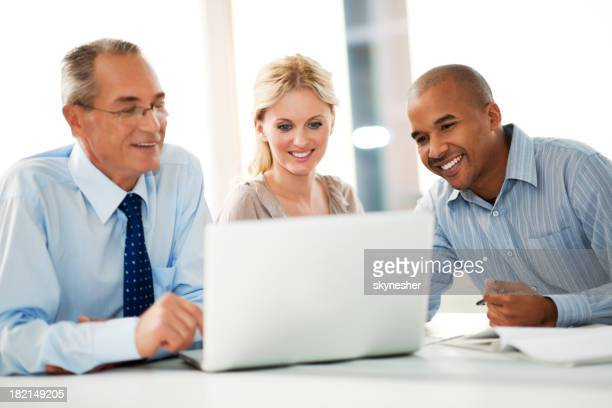 Business people working on a laptop.