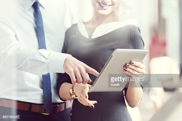 Business people working on digital tablet in an office