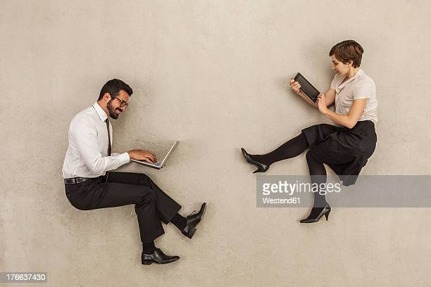 Business people working on laptop and digital tablet
