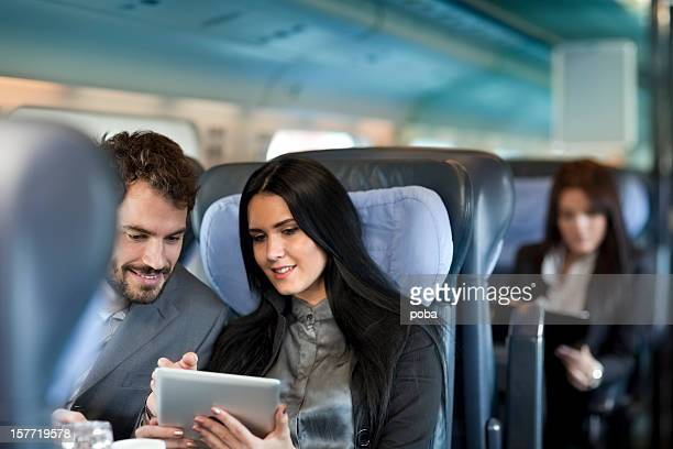 Business people working  on the Passenger  train