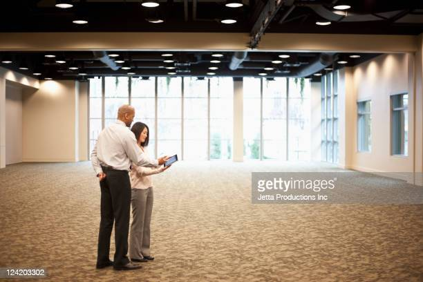 Business people working together in hotel meeting room