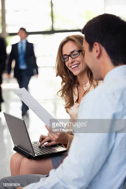 Business people working together in office lobby