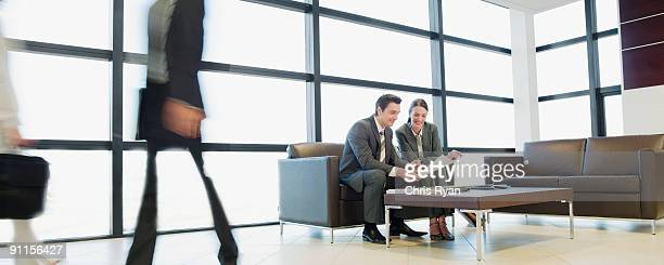 Business people working together in office waiting area