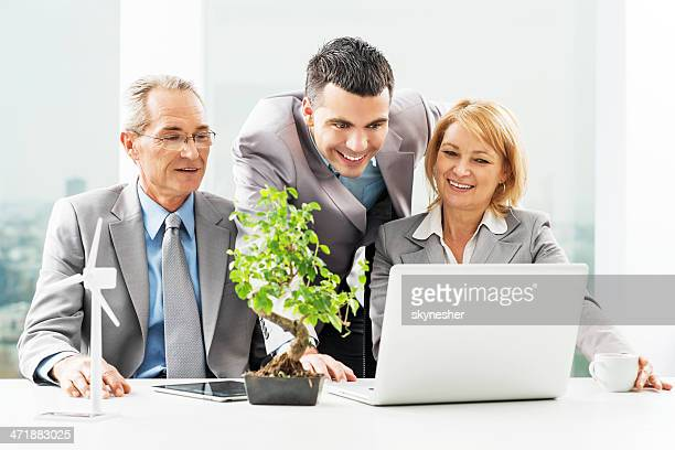 Business people working together on laptop.