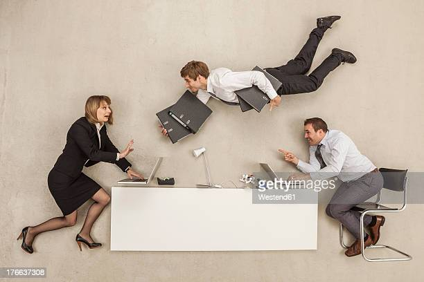 Business people working while another businessman providing files