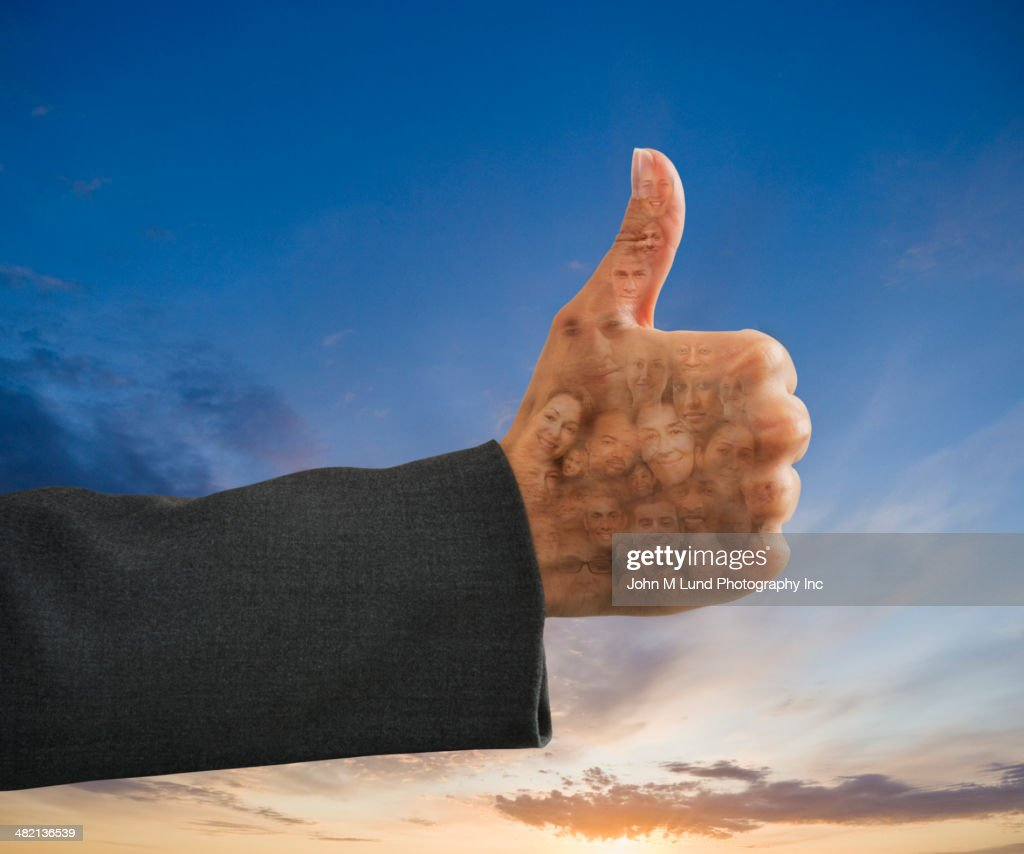 Business people's faces in thumbs up