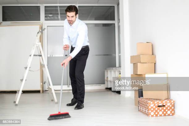 Business person cleaning his office
