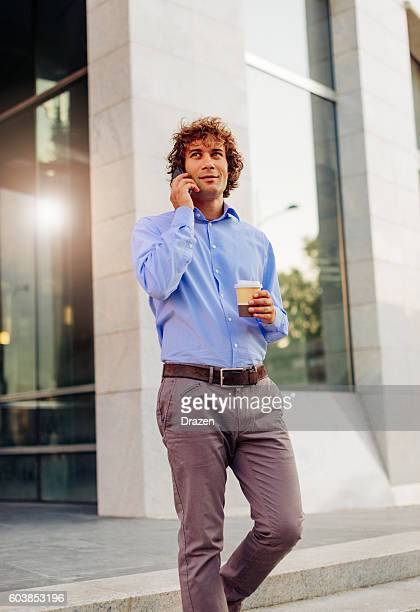 Business person coming out of the office building