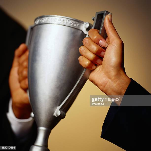 business person Holding a Trophy