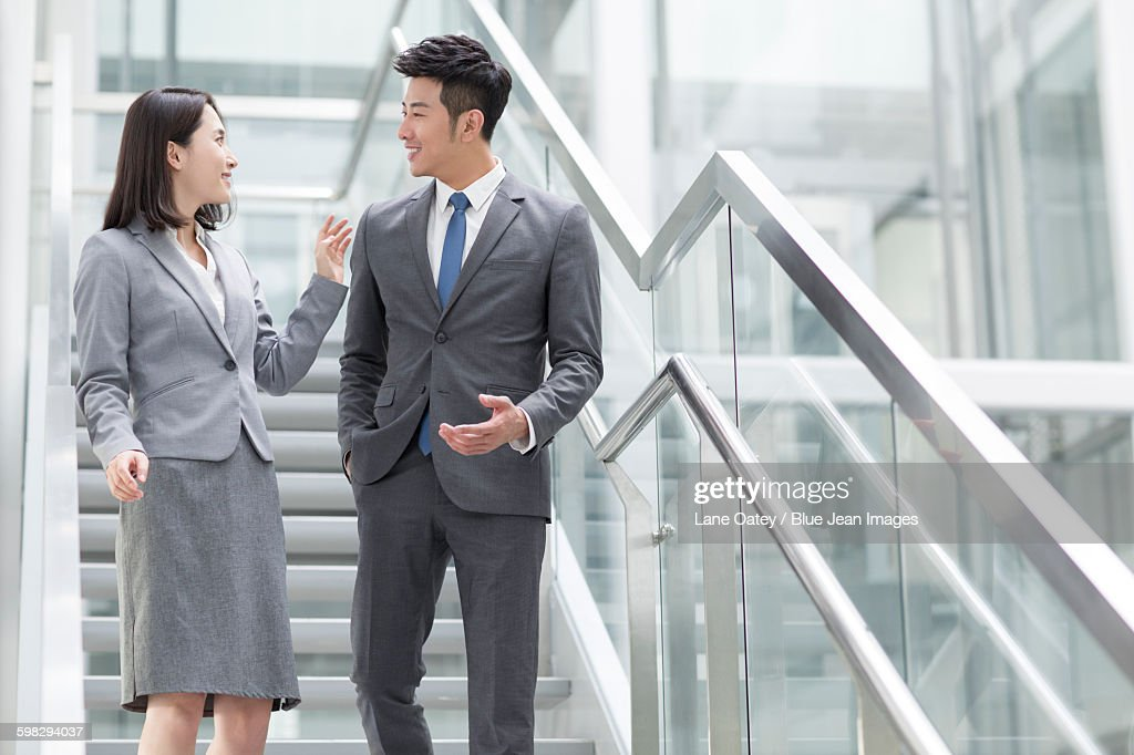 Business person talking on the stairs