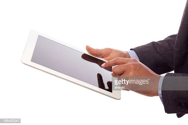 Business person's hands using a digital tablet