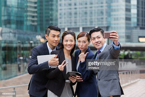 business persons taking selfie