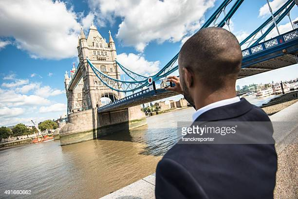 Business photographing the tower bridge