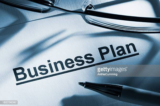 Business plan paperwork with glasses and pen