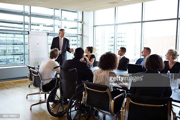 Business presentation, 1 man in wheelchair