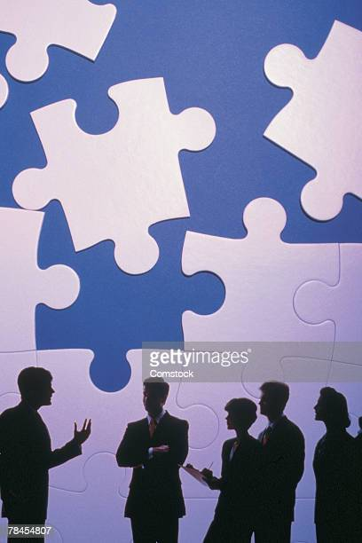 Business presentation with puzzle pieces looming