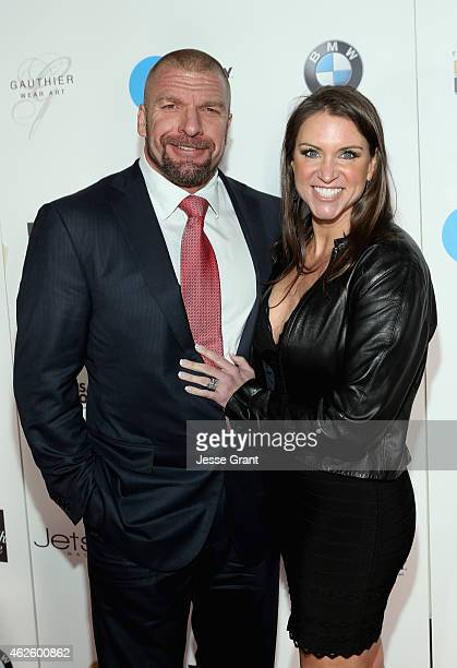 Business professional Paul Michael Levesque and businesswoman Stephanie McMahon attend The Giving Back Fund's Big Game Big Give at the home of Erika...