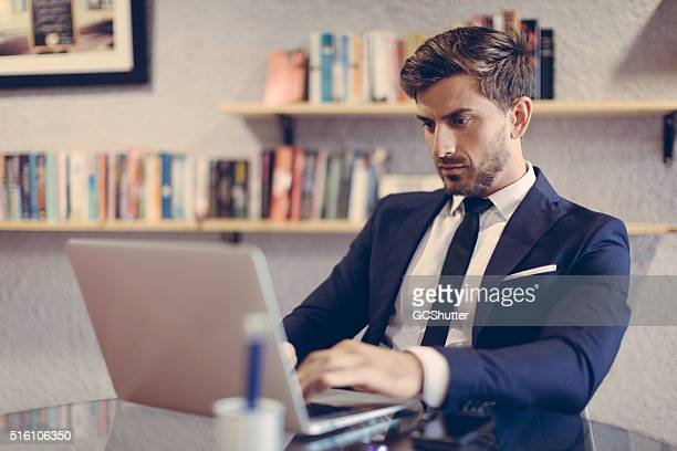 Business Professional Working on his laptop