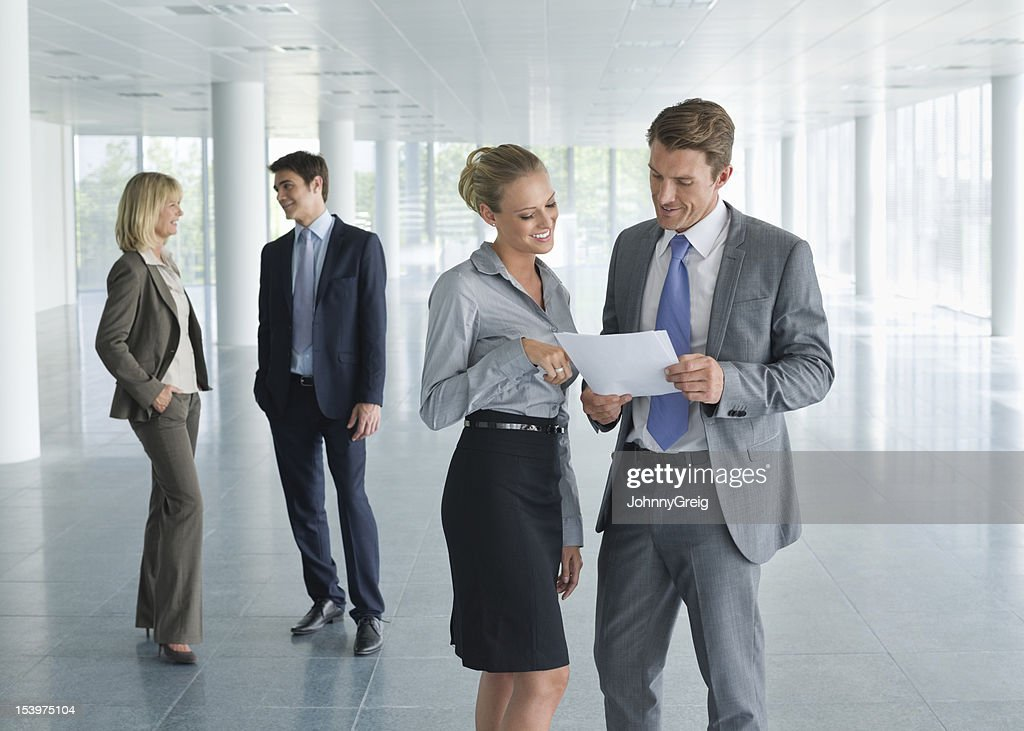 Business Professionals Discussing Work : Stock Photo