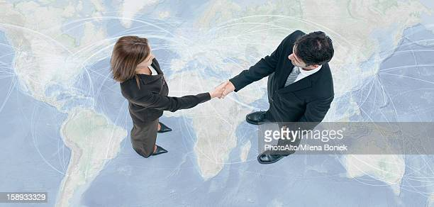Business professionals engage in global business transactions
