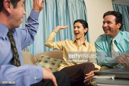 Business professionals give high five hand slap : Stock Photo