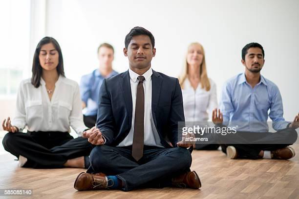 Business Professionals Meditating Together
