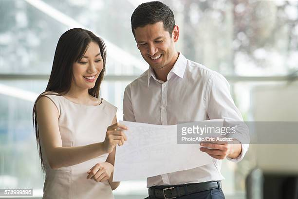 Business professionals reviewing document together