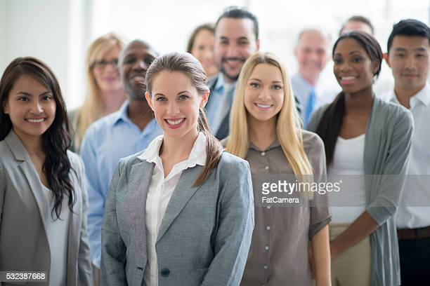Business Professionals Standing Together at Work